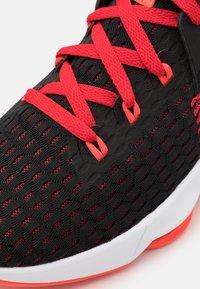 Nike Performance - LEBRON WITNESS 5 - Basketball shoes - black/bright crimson/university red - 5