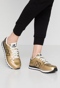 New Balance - GW500 - Sneakers - gold - 0