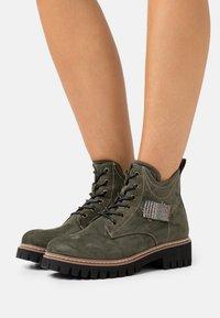 Rieker - Lace-up ankle boots - tanne/grau/rost - 0