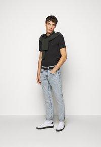 Michael Kors - SLEEK - Polo shirt - black - 1