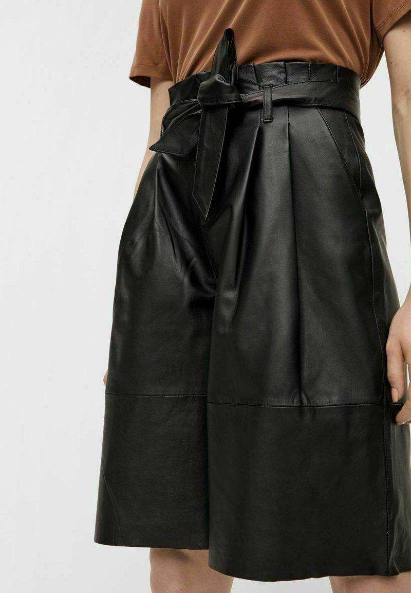 Object - OBJDANA - Leather trousers - black