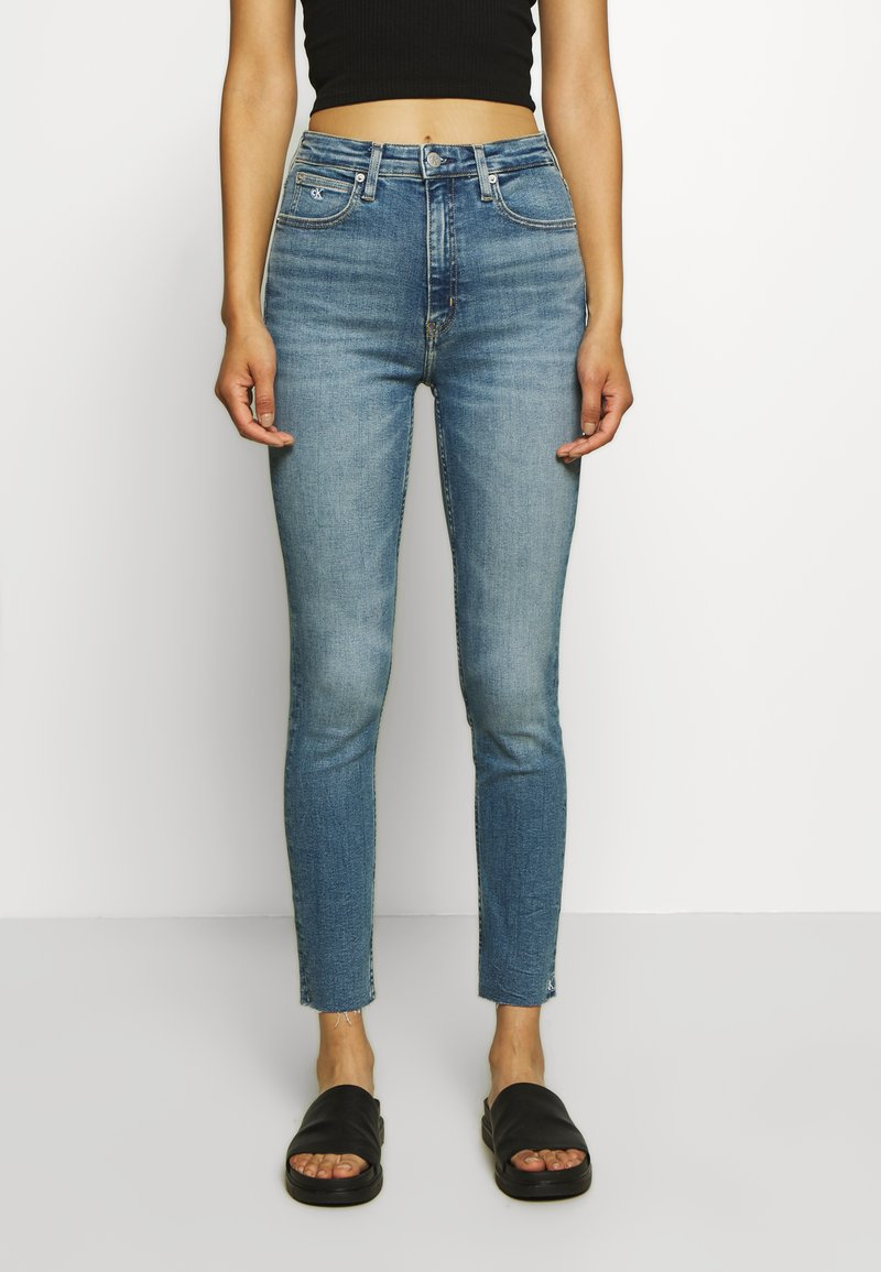 Calvin Klein Jeans - HIGH RISE SKINNY ANKLE - Jeans Skinny Fit - mid blue embro