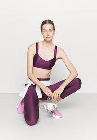 Under Armour - CROSSBACK LOW SHINE - Light support sports bra - polaris purple - 1