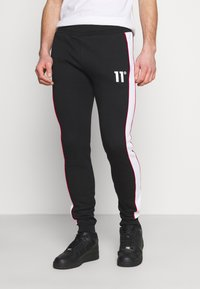 11 DEGREES - COLOUR BLOCKED PIPED JOGGERS - Tracksuit bottoms - black/white/goji berry red - 0