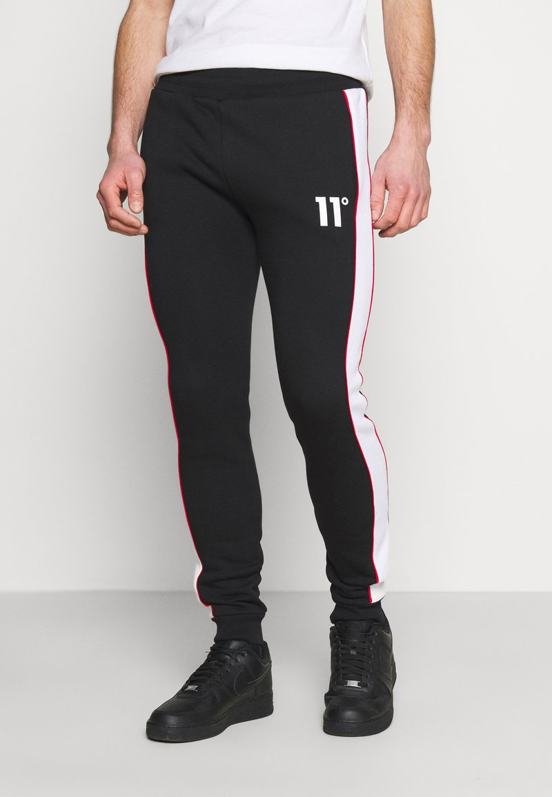 11 DEGREES - COLOUR BLOCKED PIPED JOGGERS - Tracksuit bottoms - black/white/goji berry red