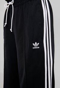 adidas Originals - BELLISTA 3 STRIPES PANTS - Träningsbyxor - black - 4
