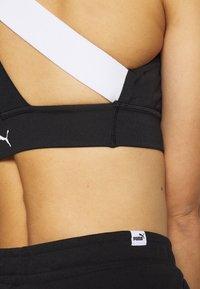 Puma - AMPLIFIED - Sports shorts - black - 4