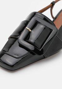 L'Autre Chose - FLAT SLINGBACK - Slipper - black patent - 6