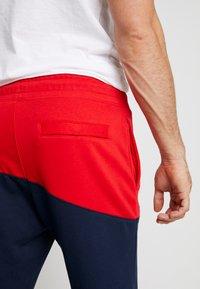Nike Sportswear - PANT  - Tracksuit bottoms - university red/obsidian/white - 3