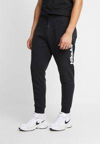Nike Sportswear - M NSW NIKE AIR PANT FLC - Træningsbukser - black/university red - 2