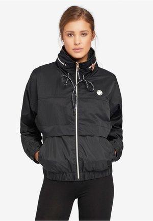 NABILA - Light jacket - black