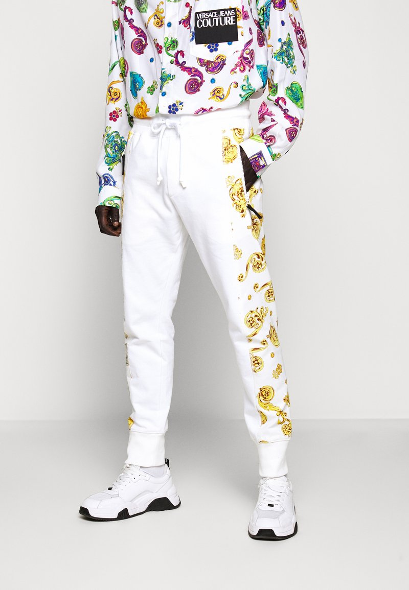 Versace Jeans Couture - JOGGERS GIOIELLI SIDE STRIPE - Tracksuit bottoms - white