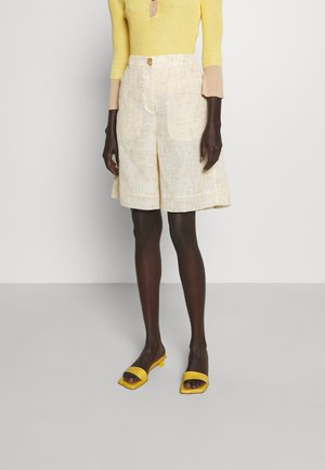 RILEY - Shorts - beige/yellow