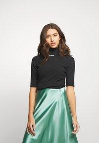 Hummel Hive - CAROLINE - Camiseta estampada - black - 0
