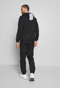 Lacoste Sport - TRACKSUIT HOODED - Tracksuit - black/white - 4