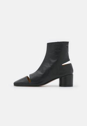 STIVALETTO - Kotníkové boty - black