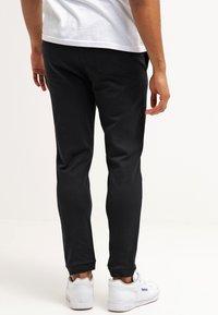 YOURTURN - Pantalones deportivos - black - 2