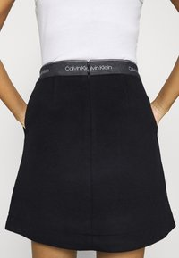 Calvin Klein - DOUBLE FACE SKIRT - Mini skirt - black - 6