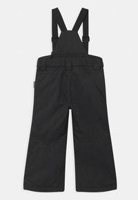 Reima - WINTER TERRIE UNISEX - Zimní kalhoty - black - 1