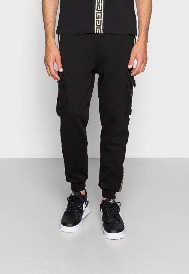 ALPHA JOGGER - Pantalon de survêtement - black