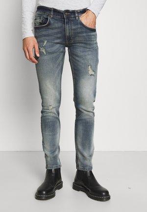 STOCKHOLM DESTROY - Jeans slim fit - dry blue