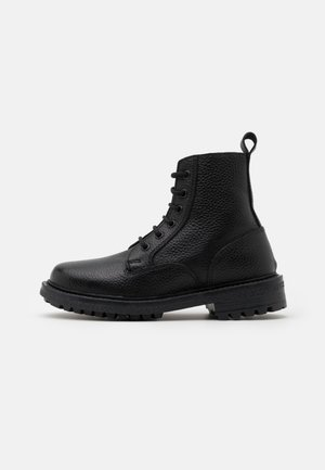 GUZO UNISEX - Lace-up ankle boots - black