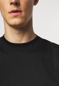 J.LINDEBERG - ACE MOCK NECK - T-shirt - bas - black - 6