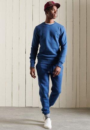 VINTAGE - Tracksuit bottoms - bright blue marl