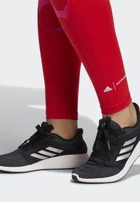 adidas Performance - MARIMEKKO - Leggings - vivid red - 3