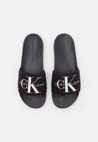 Calvin Klein Jeans - SLIDE MONOGRAM  - Matalakantaiset pistokkaat - black - 3