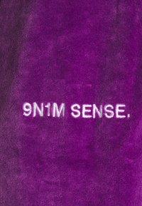 9N1M SENSE - TRACK PANTS UNISEX - Pantalon de survêtement - purple - 9