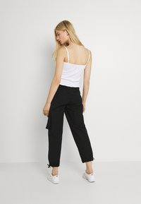 Nike Sportswear - CLASH PANT - Cargobukse - black/smoke grey - 2