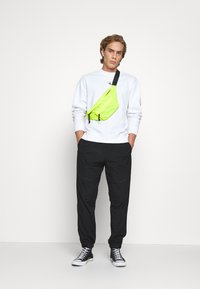 Calvin Klein Jeans - TRACK PANT - Trousers - black - 1