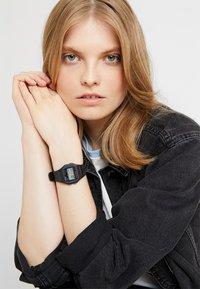 Casio - Digital watch - black - 1