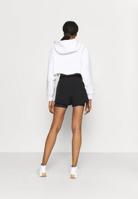 Calvin Klein Performance - SHORTS - Sports shorts - black - 2