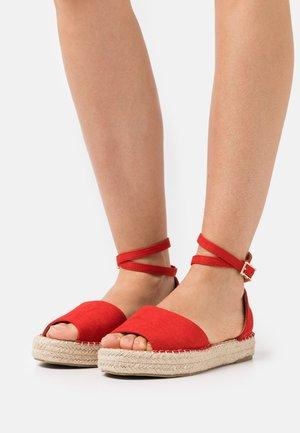 KAIRA - Platform sandals - red