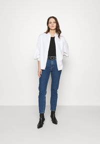 Carin Wester - IMAN - Relaxed fit jeans - denim blue - 1