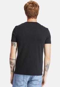 Timberland - SS DUNSTAN RIVER POCKET TEE - Basic T-shirt - black - 2