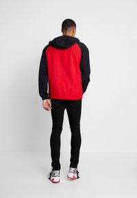 Nike Sportswear - Windbreakers - university red/black - 2