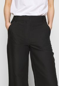 DESIGNERS REMIX - HAILEY FLARE - Trousers - black - 4