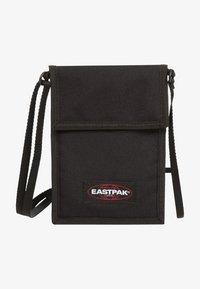 Eastpak - CULLEN CORE  - Across body bag - black - 1