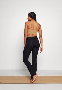Deha - TIGHT PANTS - Tracksuit bottoms - black - 2