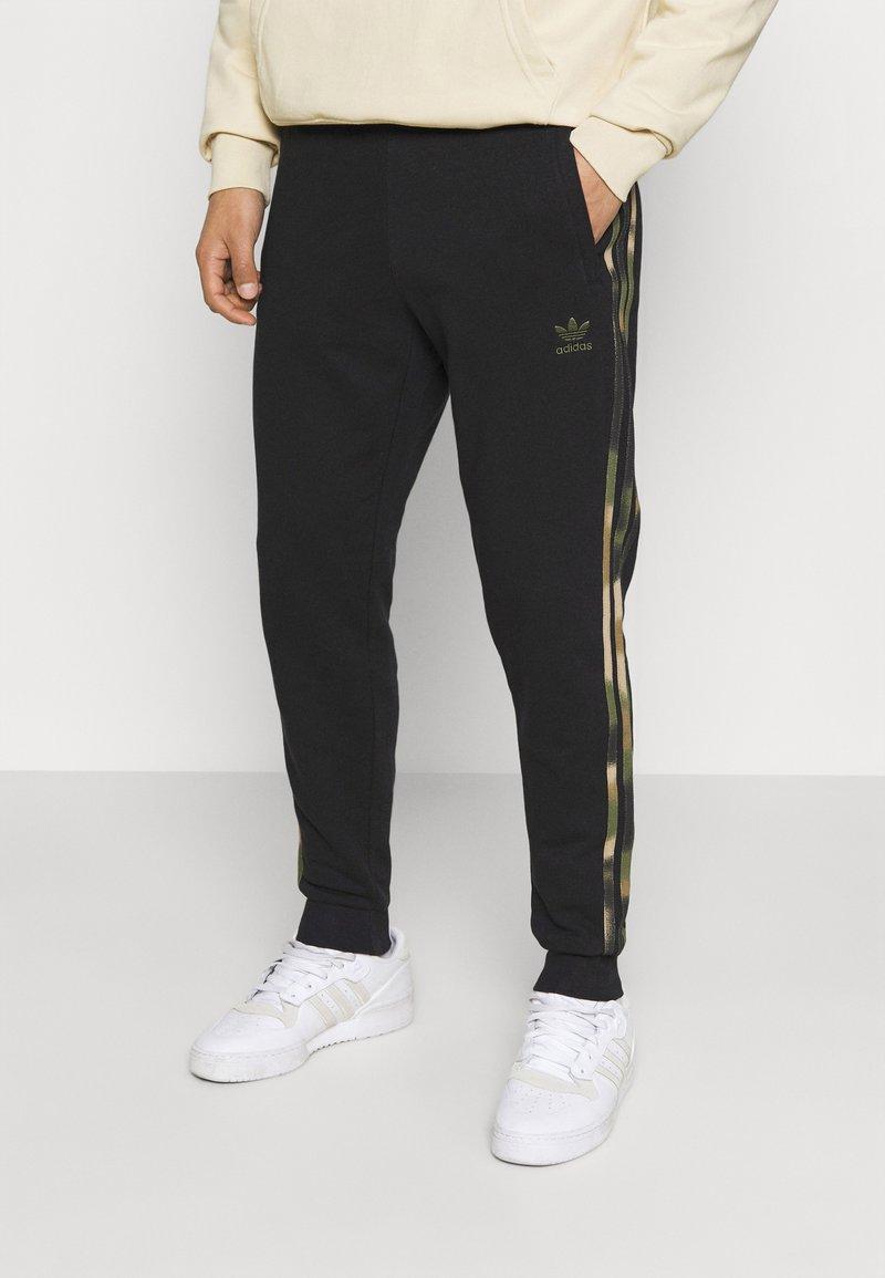 adidas Originals - CAMO  - Tracksuit bottoms - black/wild pine/multicolor