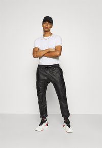 Tigha - TANO - Leather trousers - black - 1