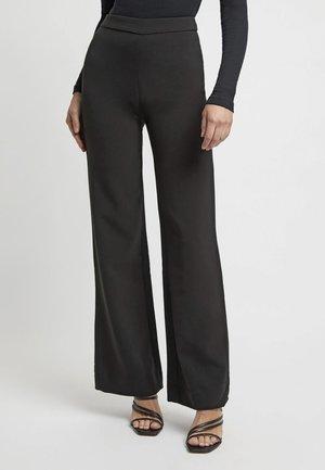 DELTA FLARE - Trousers - black