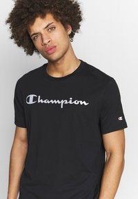 Champion - CREWNECK  - Print T-shirt - black - 4