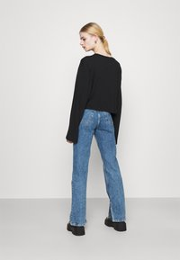 Monki - ELSIE SLIT TROUSERS - Jeans a sigaretta - thrift blue