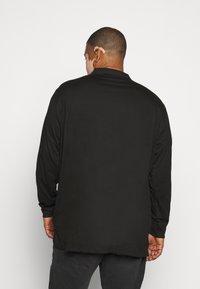 Calvin Klein - LIQUID TOUCH LONG SLEEVE - Polo shirt - black - 2
