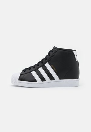 SUPERSTAR SPORTS INSPIRED MID SHOES - High-top trainers - core black/footwear white/gold metallic