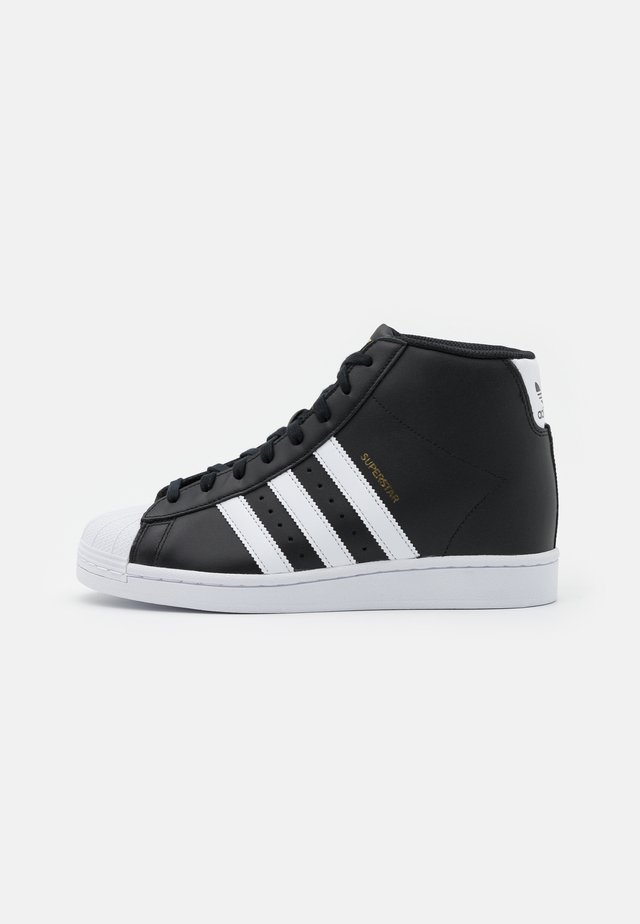 SUPERSTAR SPORTS INSPIRED MID SHOES - Vysoké tenisky - core black/footwear white/gold metallic